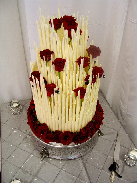 Cake Decorated With Chocolate Sticks : 3-tier Wicked Chocolate wedding cake decorated with white ...