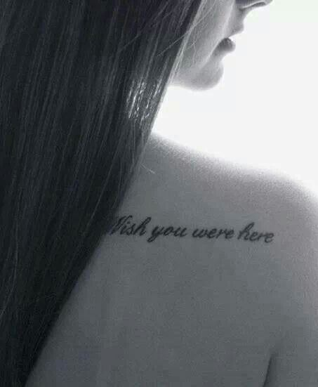 Small shoulder quote tattoo.