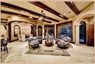 Mediterranean Living Room with High ceiling, Carpet, limestone tile floors, Columns, Ceiling fan, Exposed beam, flush light