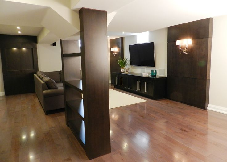 Refined by Design - Interior Design Toronto - Basement renovation with  custom wood bookshelves to hide support posts, custom wood wall panels & ar… - Refined By Design - Interior Design Toronto - Basement Renovation