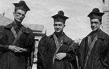 Enrico Fermi between Franco Rasetti (left) and Emilio Segrè in academic dress