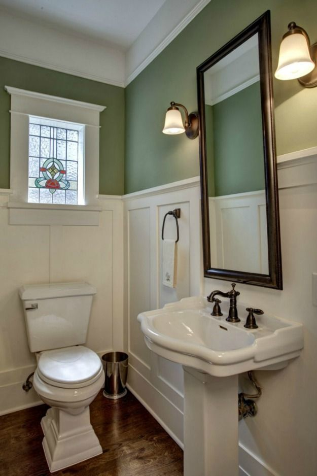 Bathroom with white paneling, muted turquoise walls and a stained glass window - Renovated Craftsman in Bellevue, WA (Frank Odle house) - Hooked on Houses
