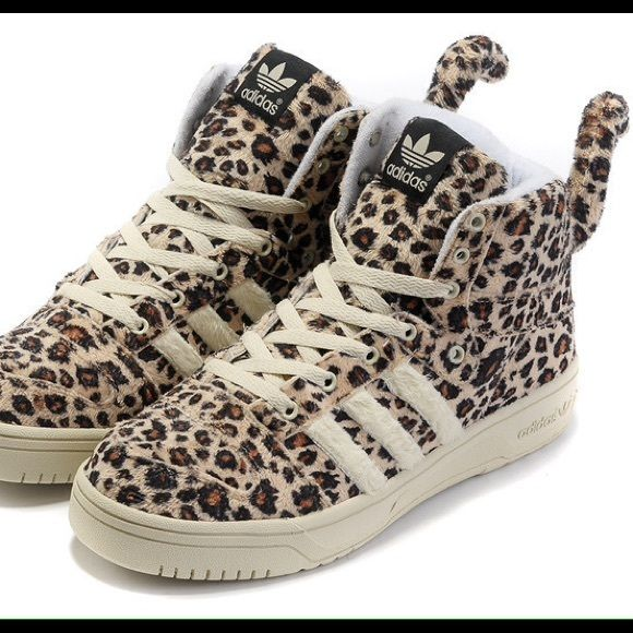Jeremy Scott x Adidas leopard sneakers Jeremy Scott x Adidas leopard sneakers!! A very limited edition collab for only the most fashionably elite. Sneakers have tails and have a fur like material. Used twice. Jeremy Scott x Adidas Shoes Sneakers