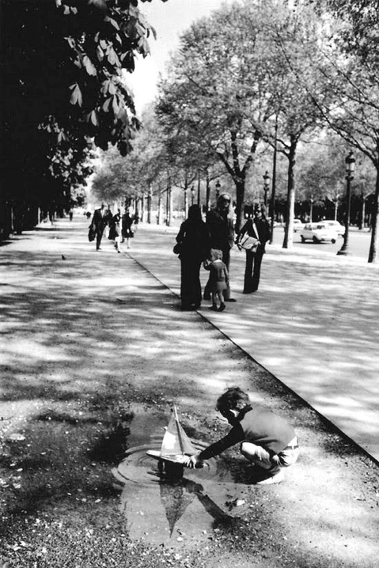 A boy, his boat, and a puddle by Robert Doisneau - Paris 1934