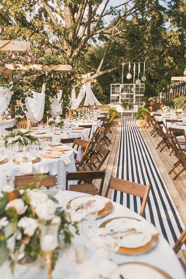 striped wedding details - photo by Cassie Lopez http://ruffledblog.com/whimsical-backyard-garden-wedding
