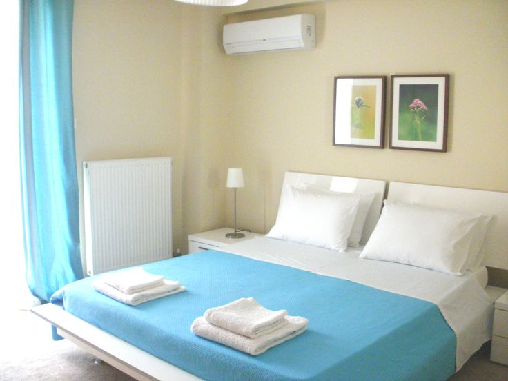 The bright master bedroom in the Lavish Apt, Piraeus, Athens, Gr. Check out airbnb.com for more details.  https://www.airbnb.com/rooms/5402166