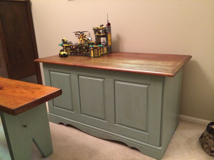Unfinished pine wood toy box that I picked up cheap....painted in Annie Sloan duck egg blue with dark walnut stained top.