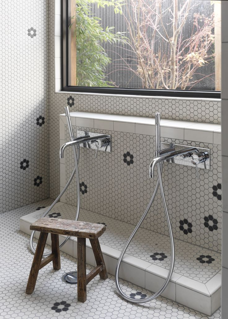 Traditional Japanese onsen style showers with irregular flower pattern at Fawkner Street Residence