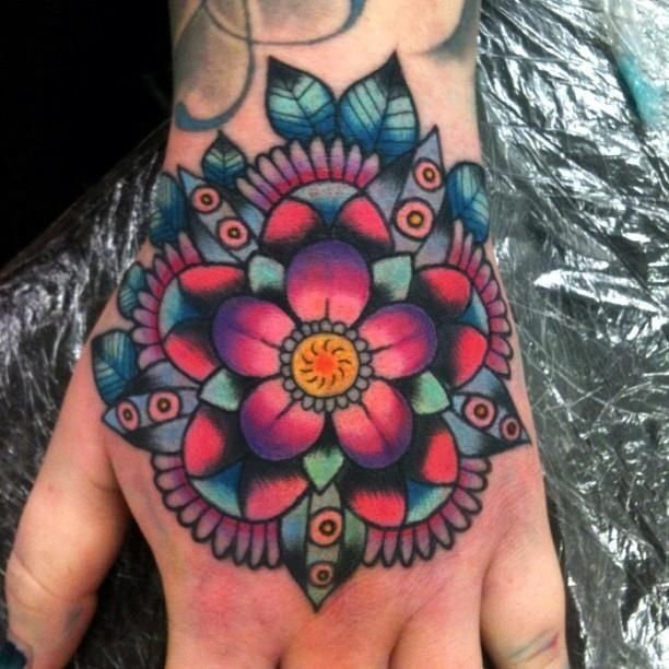 Great old school colorful mandala flower tattoo on hand