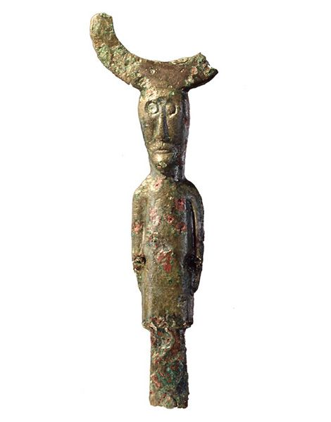 One-eyed, horned bronze figure, probably showing Oden. The broken horns might have ended in two bird heads. Dated to Late Scandinavian Iron Age (AD 400-1050). Height 4,7 cm.