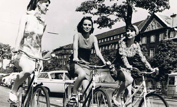 Summer girls riding their bikes in the 1950s Copenhagen
