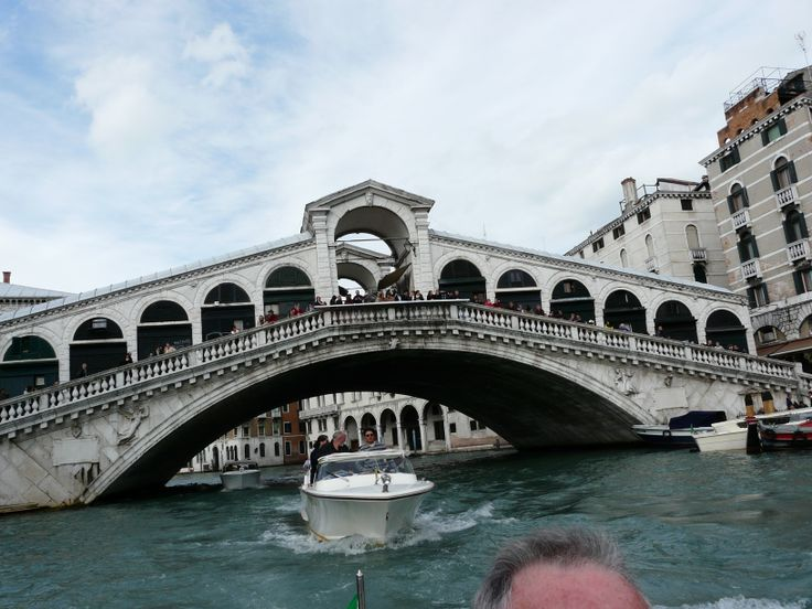 Rialto Bridge, Grand Canal, Venice, Italy one of the four bridges spanning the Grand Canal in Venice, Italy. It is the oldest bridge across the canal, and was the dividing line for the districts of San Marco and San Polo