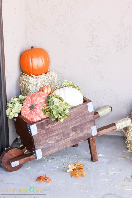 This rustic industrial wheelbarrow is perfect for your fall decor, but can work…