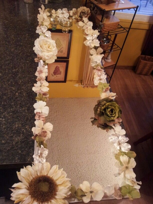 A cheap $5 mirror I've had for 20 years, flowers from Michaels & hot glue.