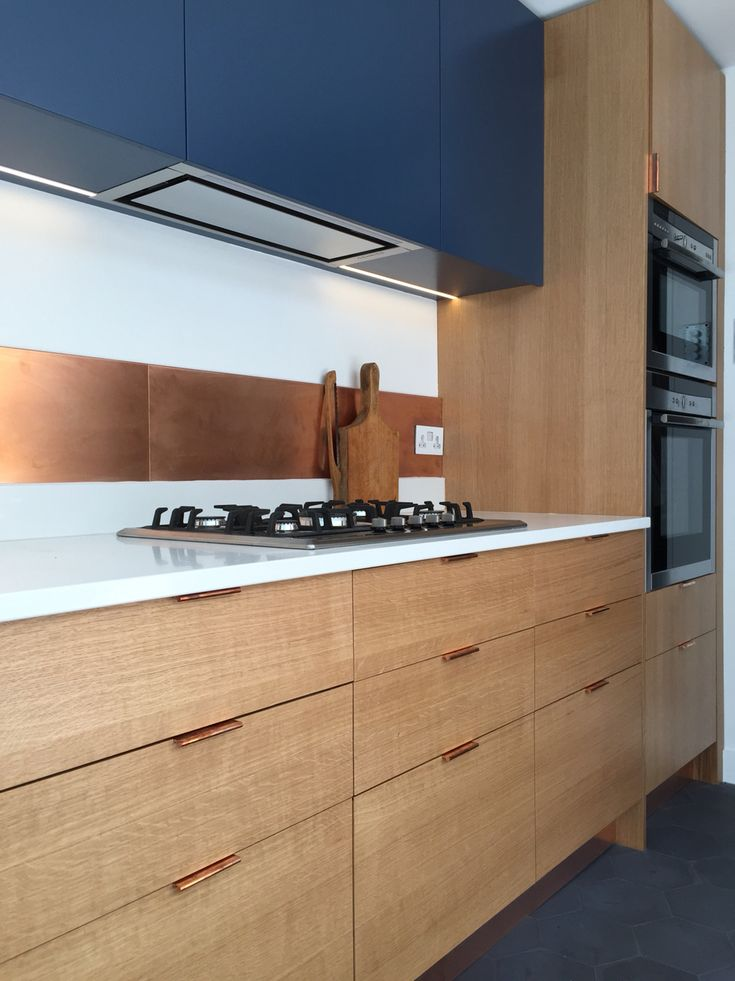 SQ1 Kitchen - Medullary Ray oak Veneer, Spray lacquered birch ply cabinets, Simonswerk copper edge pull handles and Farrow & Ball spray painted Doors. Caesar stone worktop. Absolutely love this kitchen....