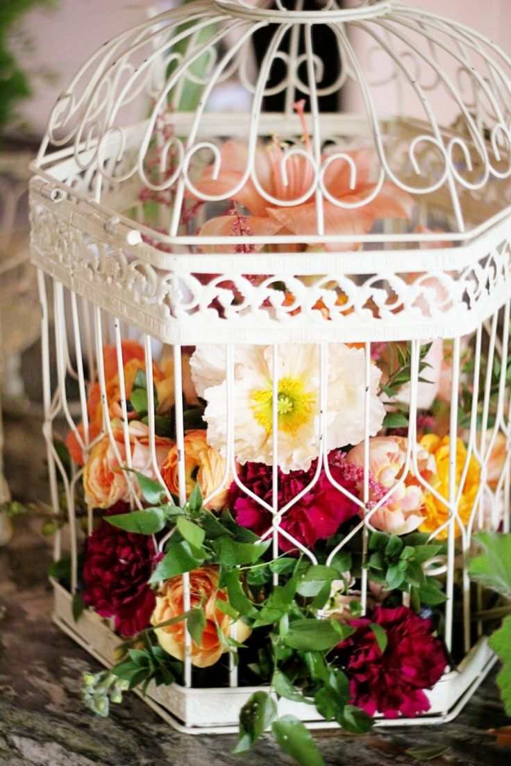 Birdcage Centerpiece with Amaryllis Tulips, Peonies, Carnation, Anemones and Roses ♥ Source: Floret Cadet