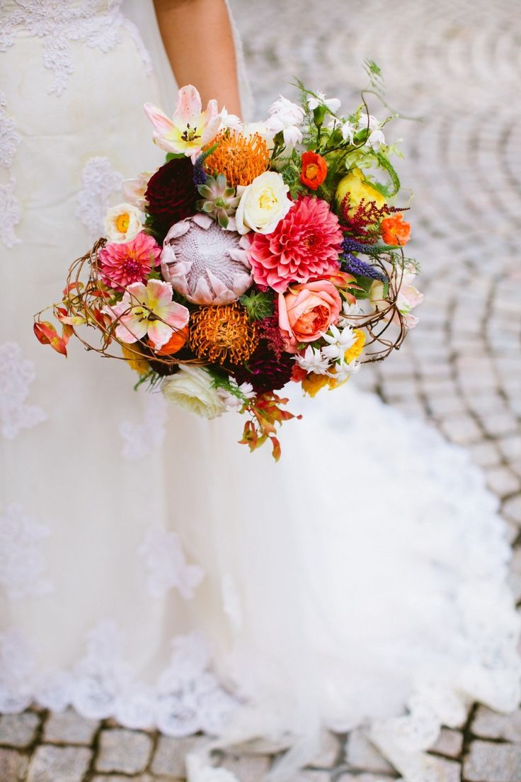 Protea, Dahlia and Lilies feature strongly in this eye-catching bouquet