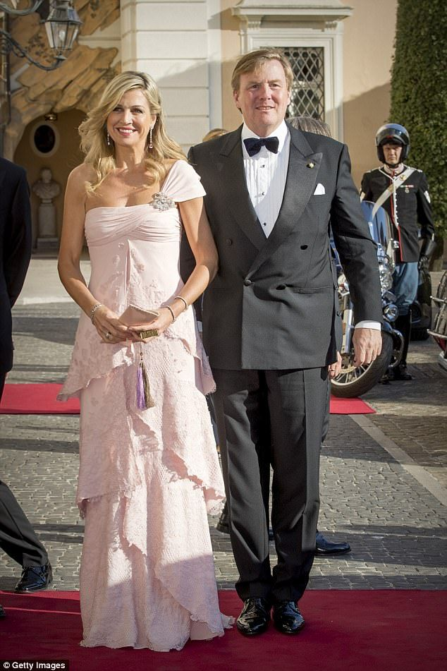 Queen Maxima dazzled in a pale pink floor length gown as she and her husband King Willem-Alexander attend a concert on the second night of their state visit to Italy