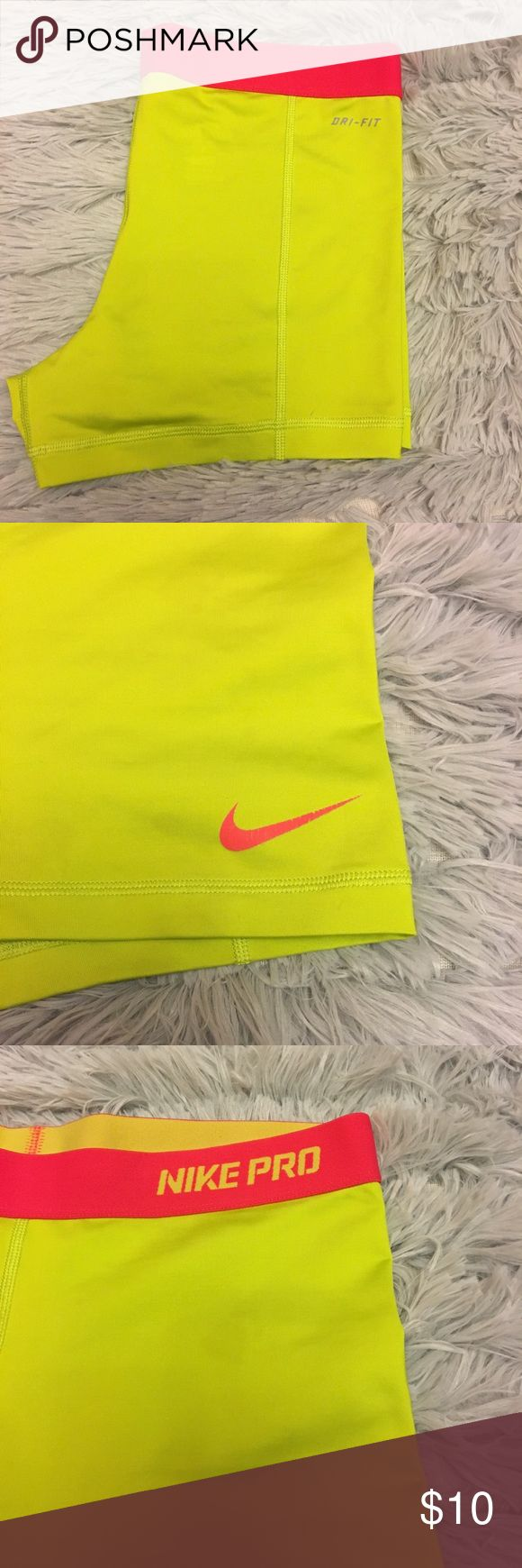 Bright Neon Running Shorts Nike Running Shorts. Bright Neon Yellow With Hot Pink Waist Band. Good Condition. Nike Shorts