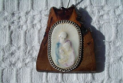 little piece of ceramic (Holly Family) and olive tree wood