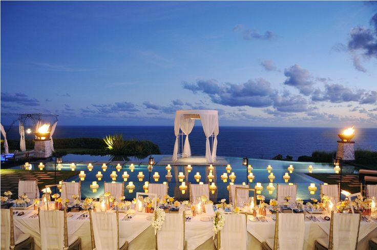The glowing candle lights over the Dinner Table a by Tirtha Bridal Uluwatu Bali