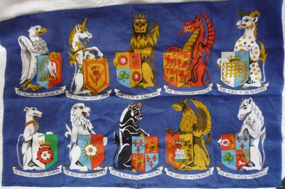 Unused vintage Irish Linen Towel  by Ulster Weavers of Ireland featuring the QUEEN'S BEASTS, mythical creatures and the coats of arms from the English monarch's genealogy, by AngelGrace on Etsy.