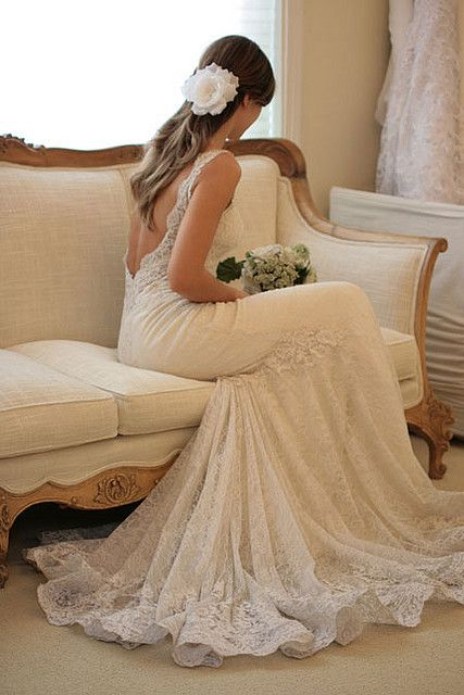 Beautiful backless lace wedding dress. I know you wouldn't wear this specifically,