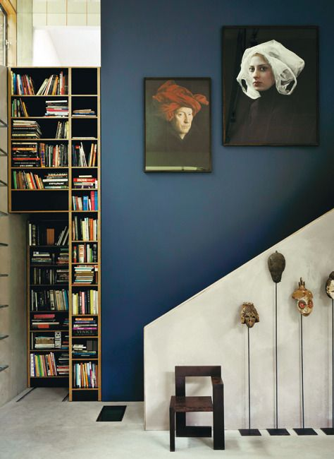 Awesome blue color for a wall. I like the art on the wall and other features in this space. <>