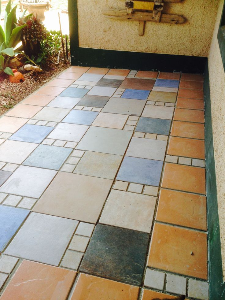RANDOM Floor tile mosaic pattern on my veranda from tiles collected over the last few years. ready for grouting