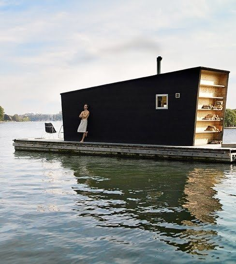 A tiny weird-shaped house on a barge exists. www.architizer.com