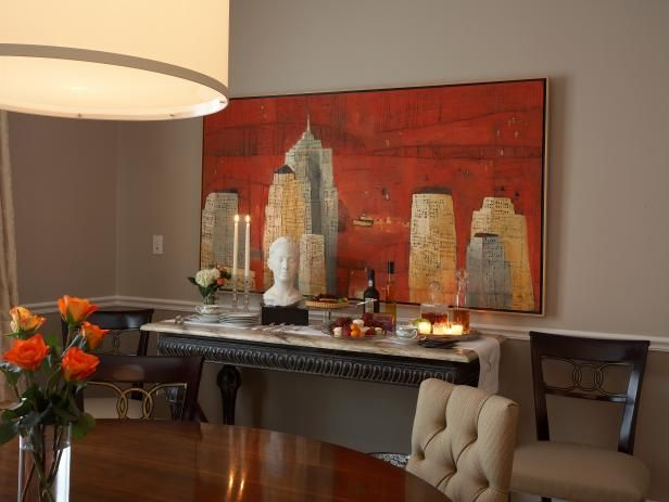 Admire the inviting artwork and soothing lighting in this dining room design on HGTV.com.