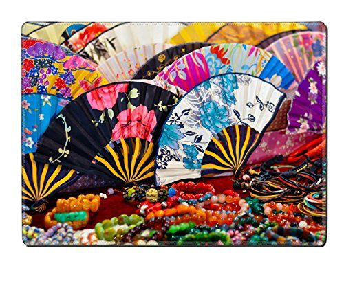 Liili Placemat Natural Rubber Material IMAGE ID 12452303 a set of colorful chinese folding fans and some bracelets