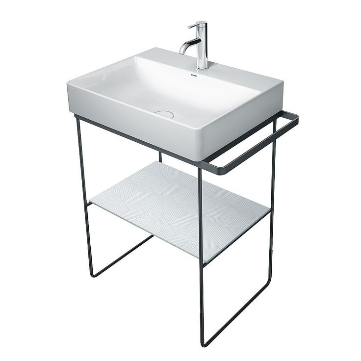 Pair your DuraSquare 600mm washbasin with this freestanding basin stand, and give a nod to the industrial trend with its linear appearance and high-quality metal finish. The metal console comes in a choice of matt black or chrome, so you can match it with your bathroom scheme. The glass shelf creates handy storage space for your everyday essentials and can be specified in a range of hues to blend in with your decor or provide an unexpected pop of colour. The towel holder can be positioned to…