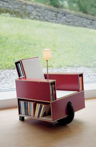 Bookinist is a movable chair designed especially for reading. It is based on the principle of a pushcart and can be rolled to a favourite spot.  About 80 paperbacks can be stored ready for use in the arms and the backrest of the chair. With a reading lamp and hidden compartments for writing utensils (reading-glass, bookmarks, pencil, pencil sharpener and a pocketbock are included) Bookinist invites you to read and think at your leisure.