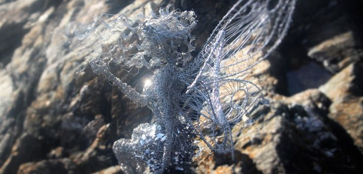 Flo the Sitting wire fairy commanding the waves in Greystones Ireland. - Emma Jane Rushworth, Garden Sculpture and Design, Greystones, Wicklow Ireland.