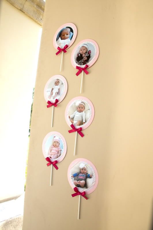 Wall lollipop decor with pics from first year