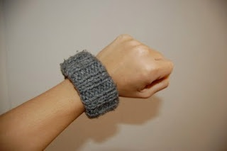Knit Bracelet using a soda can as a form underneath