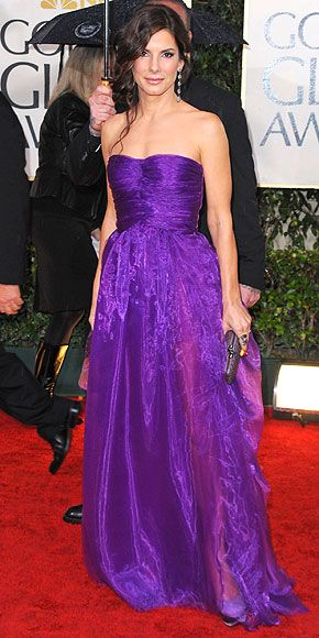 Sandra Bullock's Style Evolution | PURPLE REIGN | She won a Golden Globe in 2010 for her role in The Blind Side and won the top spot on best-dressed lists thanks to her violet Bottega Veneta gown.