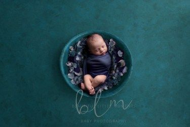 newborn-boy-teal-bowl-flowers