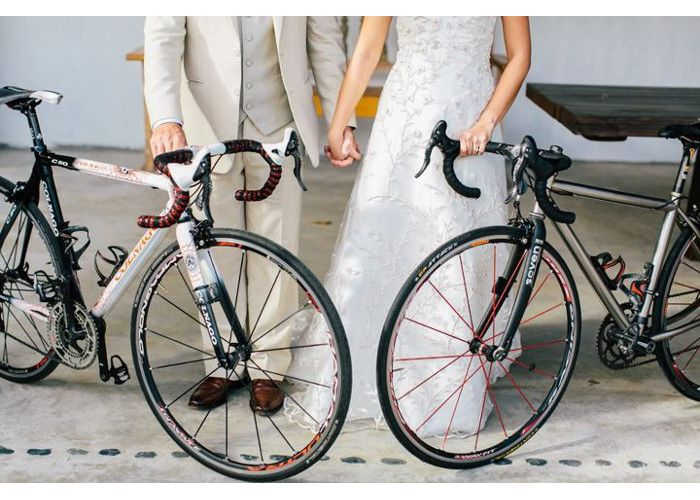 This couple's wedding photo would not be complete without their bikes.