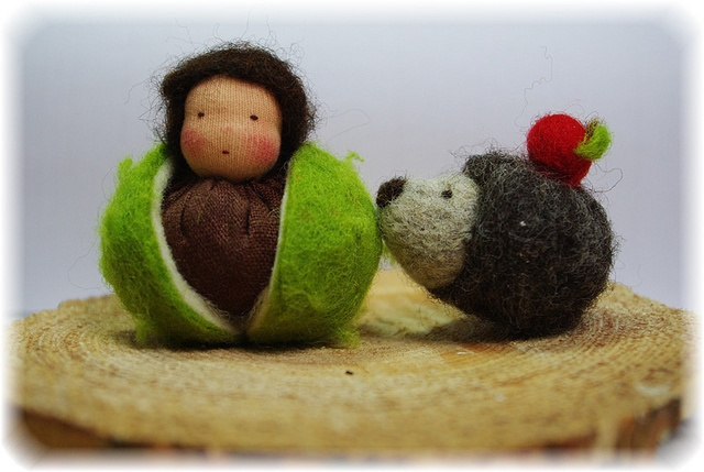 Little felted hedgehog and nut doll