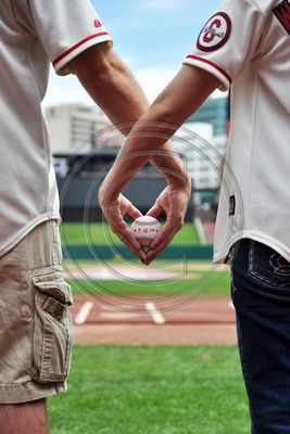 Engagement Session at Busch Stadium, love, Busch Stadium, St. Louis Cardinal Baseball, Gateway Arch, on the field, in the dugout