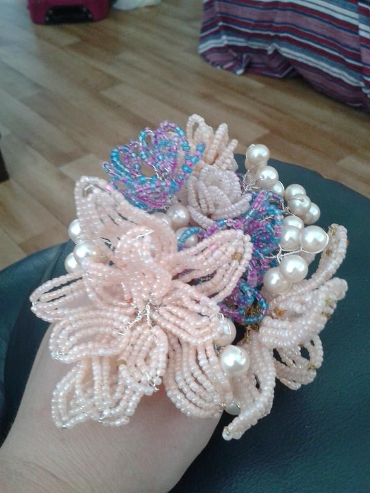While on holidays at my brothers I have been crafting fench beaded flowers. I decided to arrange some of the ones I've made in the last couple of days into a little bouquet/nosegay.  I will move these flowers to other bouquets that I'm working on though.
