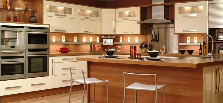 Kitchen, The Wonderful Design Of New Kitchen With Brown Table With Whiet Chairs Also Brown Laminating Flooring And White Cabinet With Wall Lights On Brown Wall ~ The Excellent Design Of The Pictures Of New Kitchens With The Interesting Decoration Of Kitchen