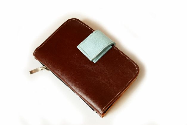 This minimalistic and modern Brown wallet is made from high quality leather. It is made of quality Brown leather and features a nice accent of Baby blue leather as a slots and top closure.  The...