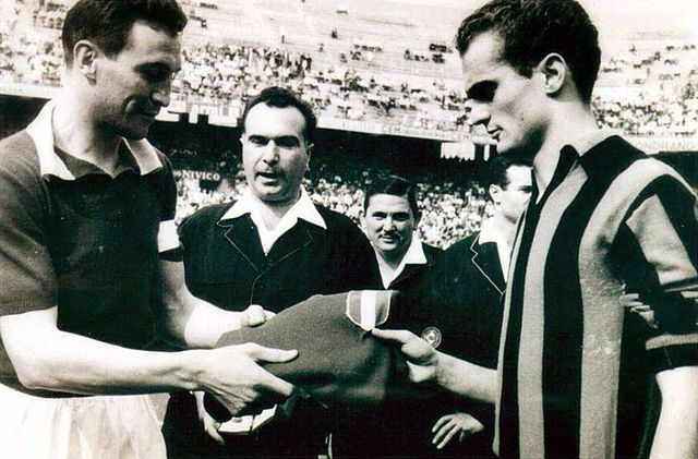 """Inter Milan vs Torino (1-1) on 26 May 1963, 34th and final day of the Serie A 1962/1963. Before the kick-off, 'Granata' captain Enzo Bearzot hands over, under the eyes of the referee Alessandro D'Agostini, to the young 'Nerazzurri' Alessandro """"Sandro"""" Mazzola the shirt of il Grande Torino worn by his father Valentino Mazzola."""