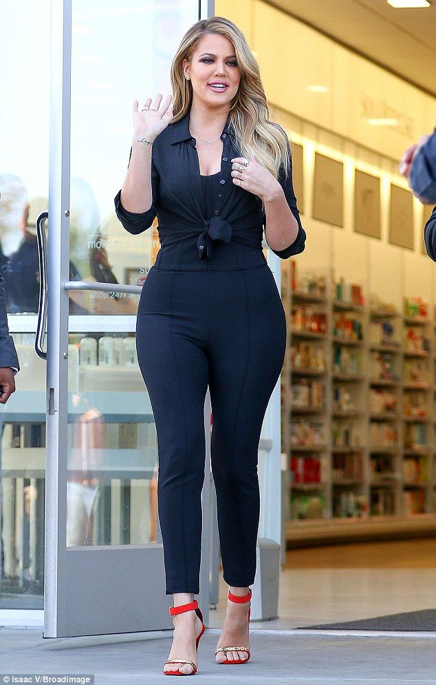 Give them a wave: Khloe seemed to be pleased with the turn-out with fans lining up outside...