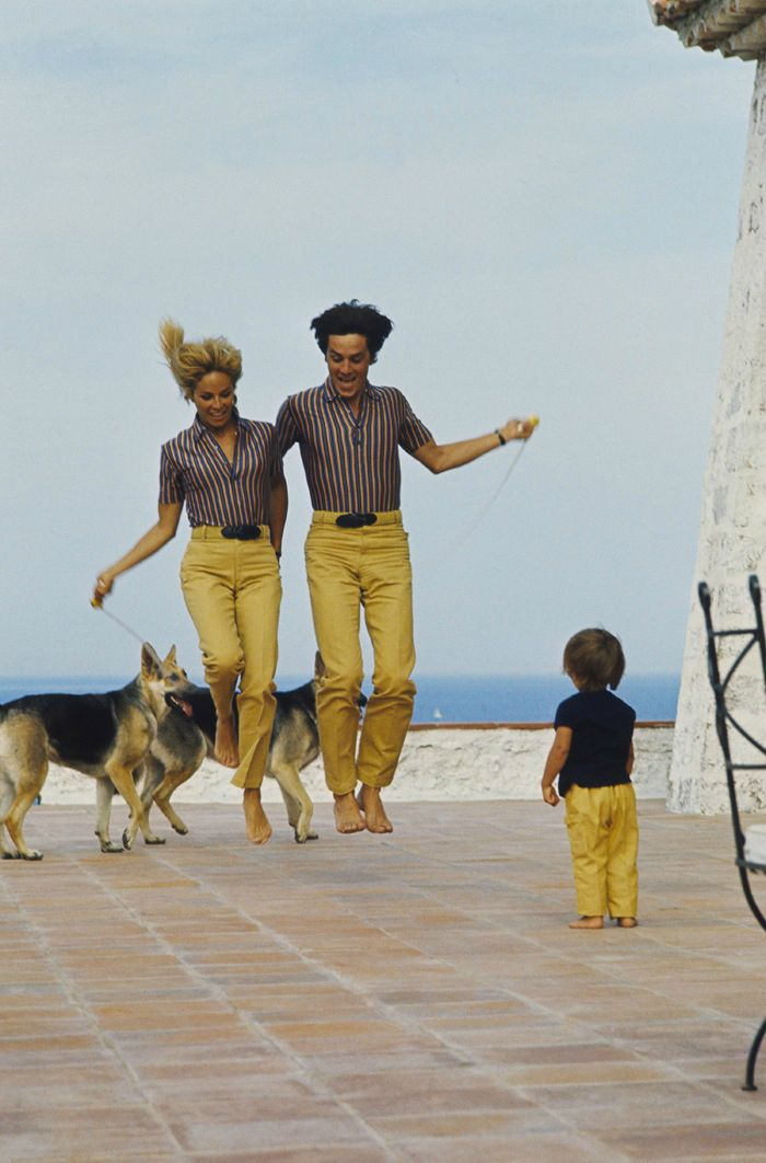 Alain Delon with Nathalie, Anthony and their dogs in Saint-Tropez.