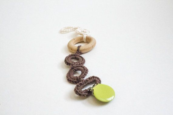 Brown baby pacifier clip with teething ring. Such a modern twist on a soother clip.  #paciclip #pacifierclip #sootherclip #babyboy #modernbaby #moderncrochet #teething #teethingring #woodteether #bohobaby
