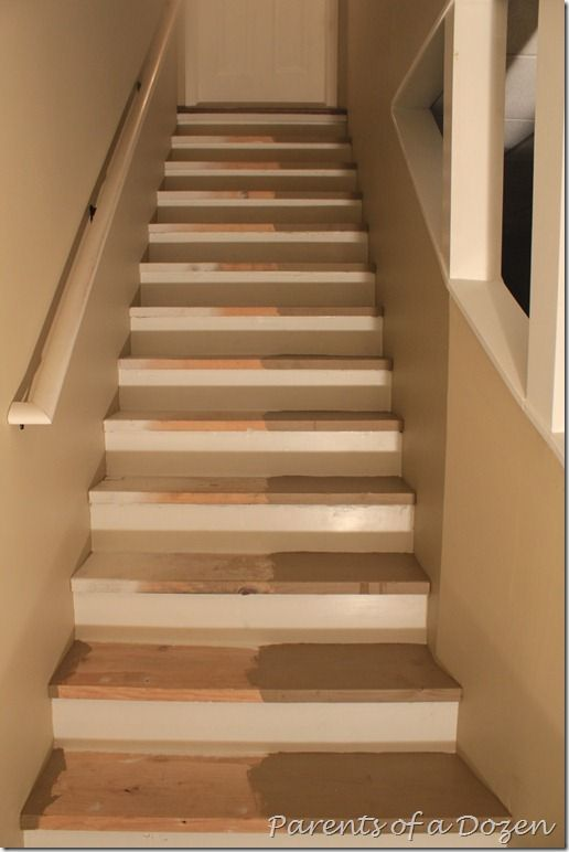 Painting basement stairs, quick & inexpensive way to transform the space before finishing with carpet or hardwood